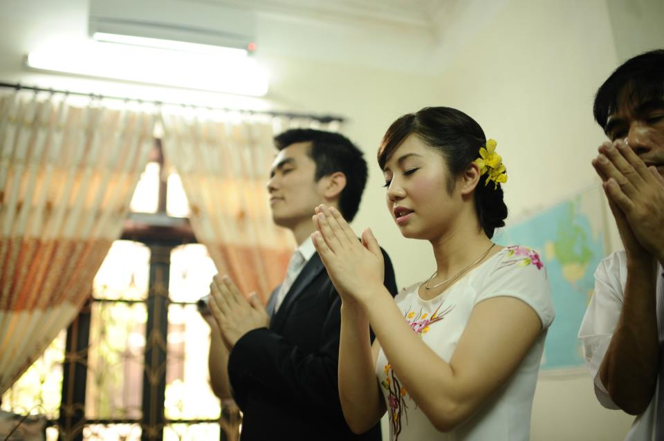 Praying at proposal ceremony